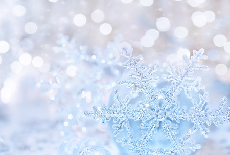 silver star: Beautiful greeting card for Xmas holidays, abstract festive background, silver shiny snowflake over blurry backdrop, stylish Christmas tree decoration Stock Photo