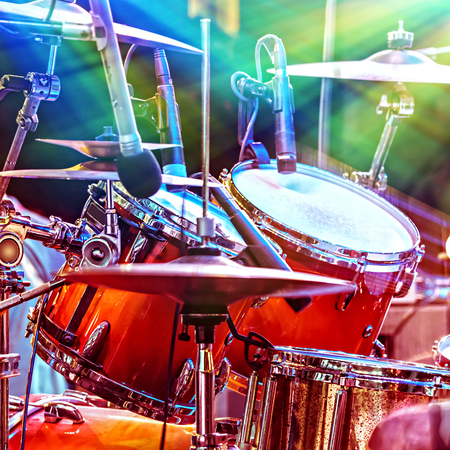 sound recording equipment: Cool drums on the stage, musical instruments, equipment for professional musicians, night performance of rock and roll band