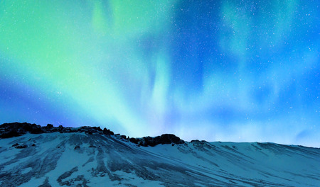 northern light: Amazing view on the Northern light and high mountains landscape covered with snow, forces of nature, Aurora Borealis, Iceland