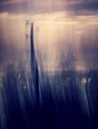 nostalgia: Industrial grunge background, electrical pylon, energy transmission, slow motion, abstract blur background, fade art, melancholy and nostalgia concept