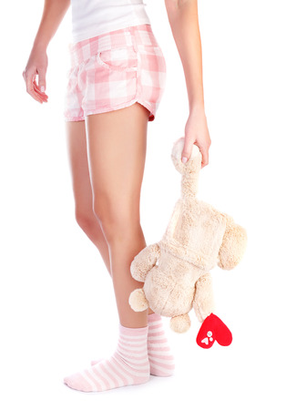 sad heart: Young girl holding in hand soft bear toy with heart isolated on white background, body part, unhappy love concept Stock Photo