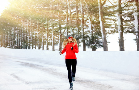 cold: Woman running in the winter park, doing exercise in cold frosty morning, workout outdoors, healthy lifestyle, wintertime sport