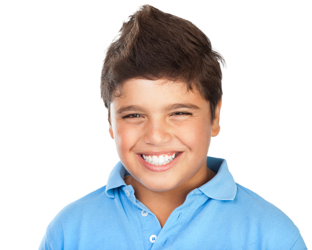 Portrait of a cheerful smiling boy isolated on white background, teenage model posing in the studio, happy facial expression, perfect toothy smile