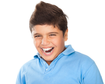 child laughing: Portrait of cute happy teen boy laughing in the studio, showing white healthy teeth, dental care, cheerful kid isolated on white background Stock Photo