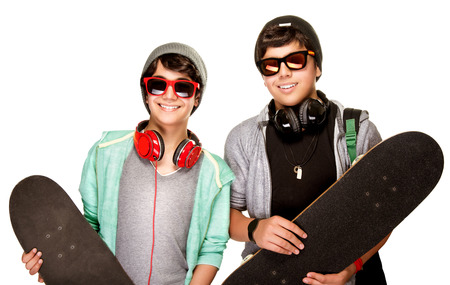 cool guy: Portrait of two happy teen boys with skateboards isolated on white background, cool trendy look, active urban lifestyle of youth