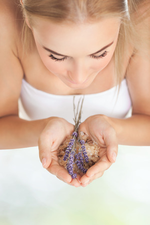 closing time: Closeup portrait of pretty girl enjoying gentle aroma of lavender flowers, closing eyes of pleasure, healthy lifestyle, body care, spending time in a spa salon, selective focus