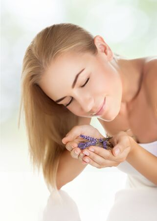 closing time: Closeup portrait of pretty girl enjoying gentle aroma of lavender flowers, closing eyes of pleasure, healthy lifestyle, body care, spending time in a spa salon
