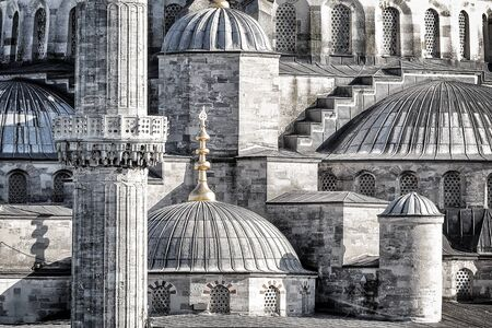 exterior architectural details: Closeup photo of a beautiful Blue Mosque background, details of an exterior of an ancient architectural masterpiece, black and white photo, Istanbul, Turkey