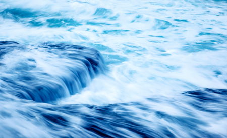 slow motion: Slow motion waves background, beautiful stormy sea, streaming water on the rocks, abstract blue natural background Stock Photo