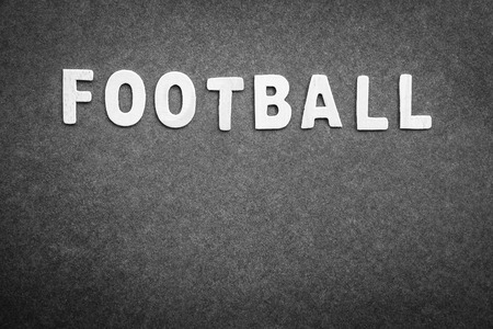 text space: Gray background with word football on it, abstract football backdrop with text space, score board