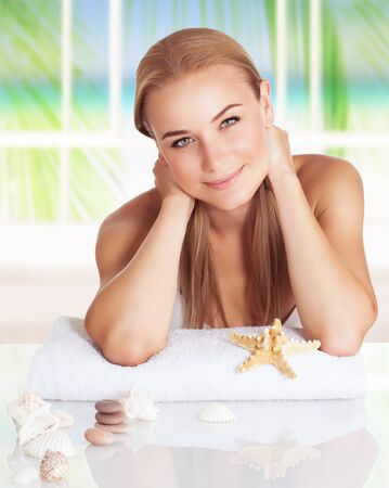 day spa: Portrait of a nice girl enjoying day spa on the beach resort, enjoying the house with sea and tropical nature view Stock Photo