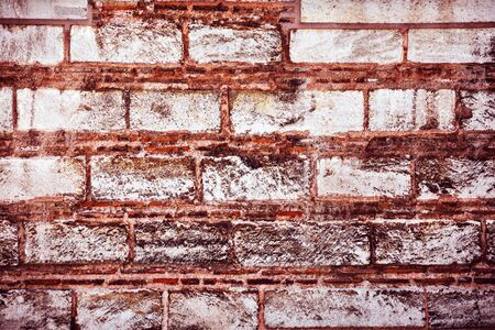 old building facade: Brick wall background, abstract architectural backdrop, old grunge brick texture, aged building facade, construction concept