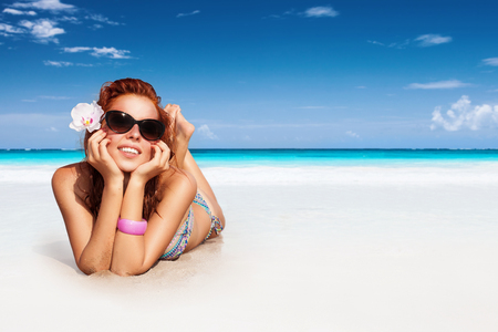 Nice girl relaxing on the beach, spending summer vacation on the spa resort, enjoying bright sunny day, photo with copy space photo