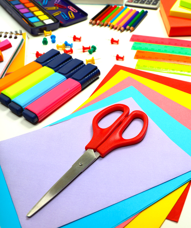 school things: School supplies background, colorful paper, markers, pencils and other different objects on the desk, education and art in the school