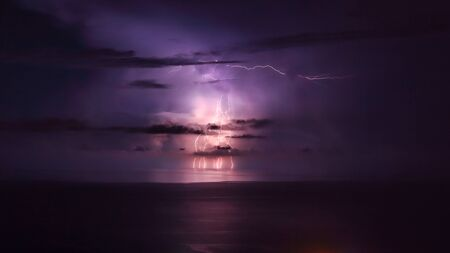 amazing wallpaper: Purple lightning over the sea, powerful thunderbolt, amazing night landscape, stormy weather in the sea, beautiful natural wallpaper