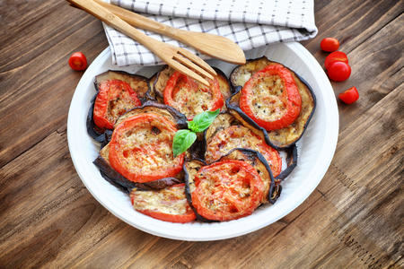 main course: Baked eggplant with tomatoes as tasty vegetarian pizza topping, main course in a holiday day, traditional italian food, organic nutrition