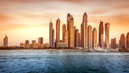 sunset city: Beautiful Dubai cityscape, panoramic view of the modern city on the bank of gulf in sunset light, famous touristic place, United Arab Emirates Editorial