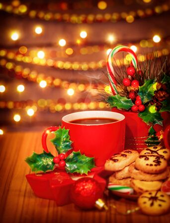 chocolate treats: Merry Christmas greeting card, beautiful cozy festive sweets still life, tasty homemade cookies with red cup of hot chocolate on the wooden table, delicious treats for Santa