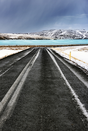 beautiful weather: Frozen lake view, beautiful winter landscape, cold extreme weather, road trip to Iceland, winter time holidays in Scandinavia, escape concept Stock Photo