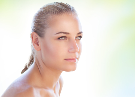 Portrait of a nice blond woman over clear background, conceptual photo of natural beauty and skin care, day spa