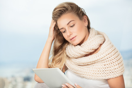 Portrait of a beautiful smart female working at home on the tablet, wireless communication, student girl doing homework on the touchpad, modern life of young people photo