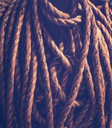 Vintage rope background, sailboat rope, safety equipment on the ship, brown old wallpaper, industrial material Stock Photo