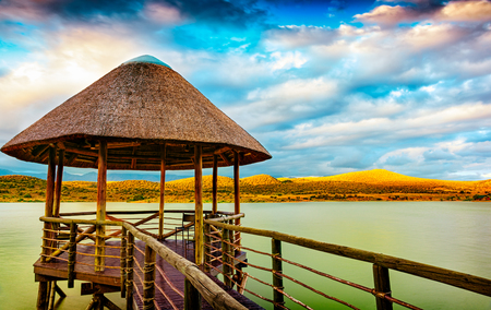 View point on the lake and mountains around, summer vacation in the romantic hotel in exotic country, beautiful nature of South Africa Banco de Imagens - 88439890