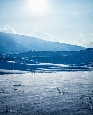 Beautiful winter landscape, panoramic view of a hills ans mountains covered with snow in bright sunny day, cold frosty weather