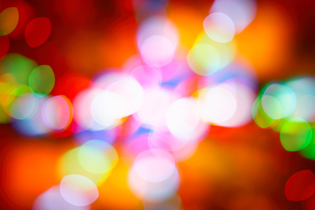 Festive colorful bokeh background, abstract blurred backdrop, outdoors illumination in Christmastime, happy New Year night