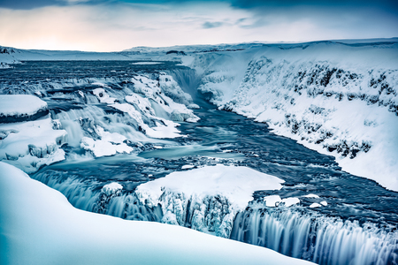 Amazing view on the gorgeous Gullfoss waterfall, cold but wonderful wintertime landscape, famous touristic place located in the canyon of Olfusa river in southwest Iceland
