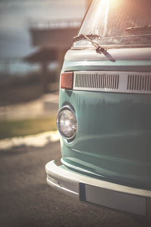 Rare vintage camper van, renovated car of 70s, nice old vintage blue bus, happy travel, road trip in exclusive car on a bright sunny day Stock Photo