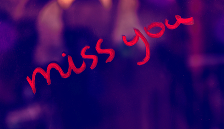 Conceptual photo of a sassy love, handwritten phrase miss you with a cheeky hint, Valentines day holiday background  Foto de archivo