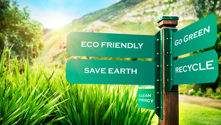 Signpost in the park with conceptual directions, eco friendly, go green, recycle and save earth, conceptual photo of ecology pollution and needs to protection nature