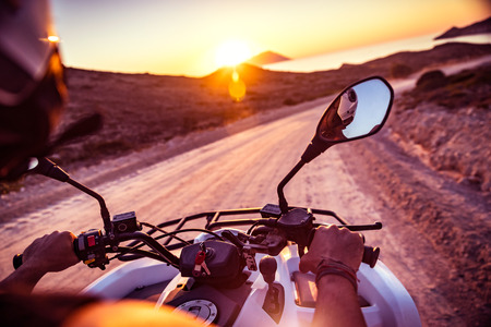 Travels on the bike, riding on the motorbike along Greece, active sportive summer adventure, driver enjoying summer vacation