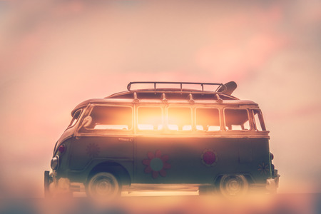 Campervan on sunset, penetrating rays of the sun through the windows of the car, home on the wheels, active summer traveling