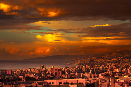 Beautiful coastal city on sunset, amazing view of a town stretches from the mountains to the sea, amazing panoramic view, Lebanon