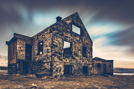 Old damaged house, ruins of building on the wasteland, weathered and abandoned home in Iceland, Scandinavia, Europe