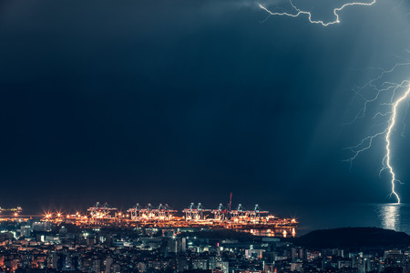 Lightning over night city, beautiful magical nighttime cityscape near the sea, lightning strikes, Beirut, Lebanon