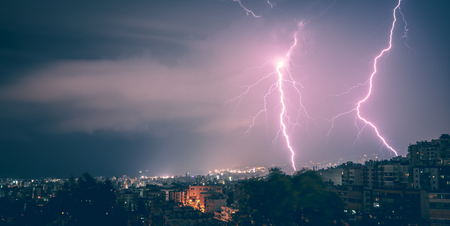 Beautiful view on two lightnings over city at night, beauty and danger of nature, summer time weather in Beirut, Lebanon