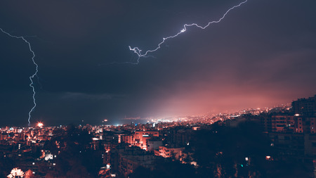 Beautiful view on lightning over city at night, beauty and danger of nature, summer time weather in Beirut, Lebanon