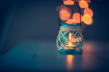 Beautiful vintage candlestick on blurry lights background, cozy decor in restaurant interior, romantic candlelight atmosphere 写真素材