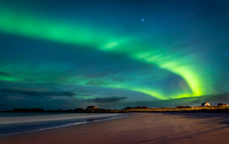 Northern lights, beautiful landscape of a green light in the night starry sky, amazing natural beauty of Lofoten archipelago, Gimsoya, Norway