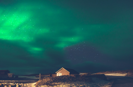 Beautiful view on the Aurora Borealis, amazing green light on the night sky, wonderful nature of Iceland