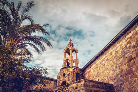 Ancient monastery, view on a great old orthodox church over sky background, vintage bell tower, Middle East, Lebanon