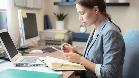 Business woman at work, clever young specialist works with financial documents, modern life of successful people, female entrepreneur
