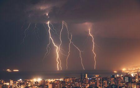 Beautiful lightning over night city, amazing cityscape with many bright zippers over it. Beirut, Lebanon Stockfoto