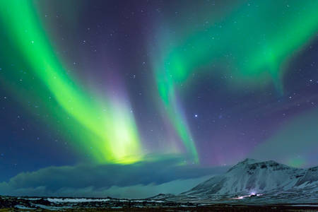 Beautiful view on Aurora Borealis, the amazing northern light in the night sky, wonderful nature of Iceland Archivio Fotografico