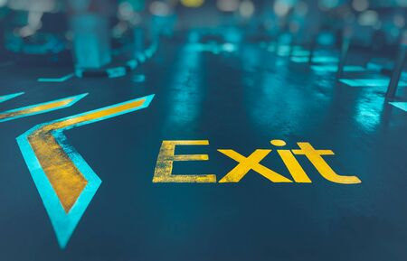 Exit background, big yellow arrow to exit from subway, direction sign, conceptual imahe of the way out, urban life, modern underground system Banco de Imagens