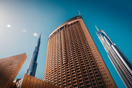 Luxury downtown of Dubai, bottom view on modern futuristic buildings, contemporary city, UAE
