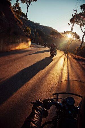 Bikers. Riding Mountainous Highway. Ride Adventure on Sunset. Summer Outdoor Activity. Travel Around the World.
